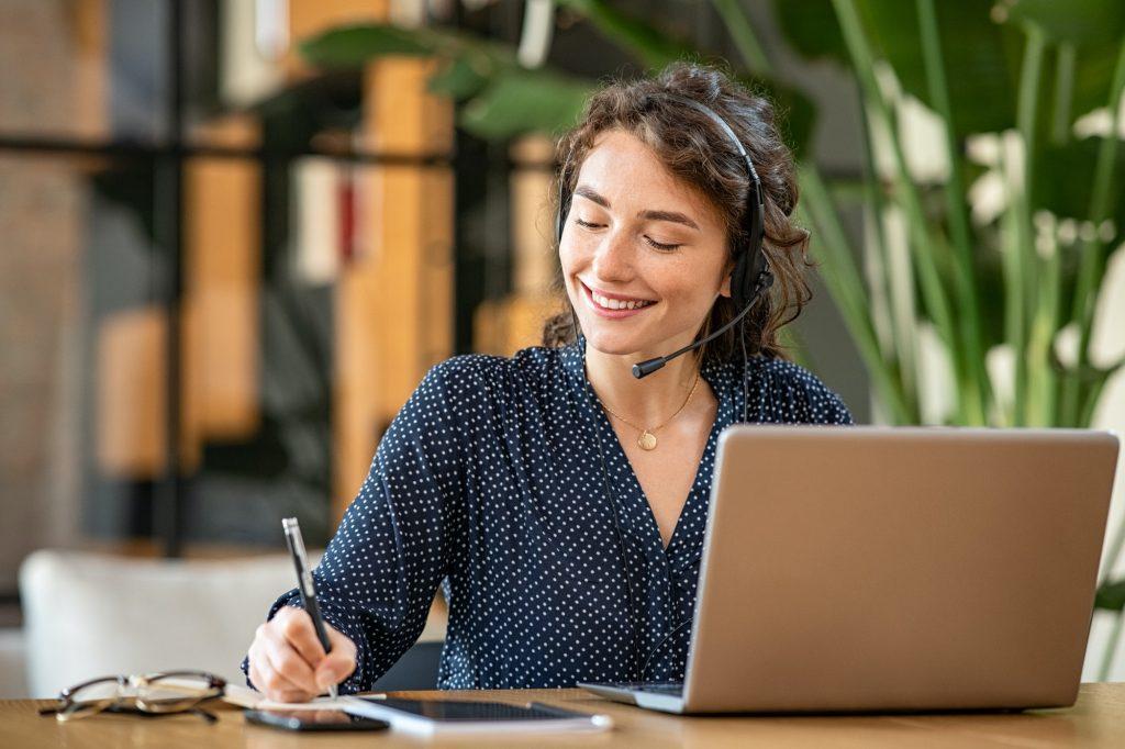 Successful customer service representative using laptop at office